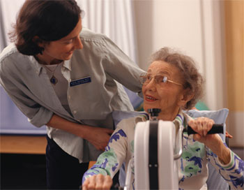 A senior patient exercising her arms as part of physical rehabilitation