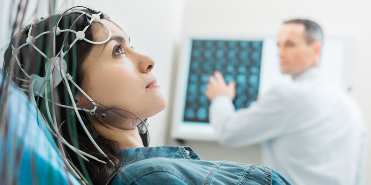 Woman being treated by her neurologist
